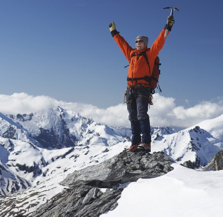 mountain climber standing on top of the summit