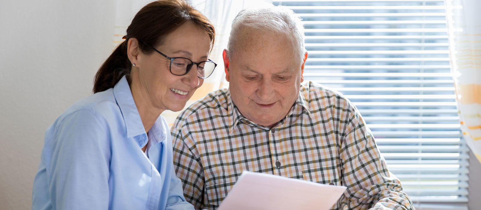 Older couple looking at paperwork.